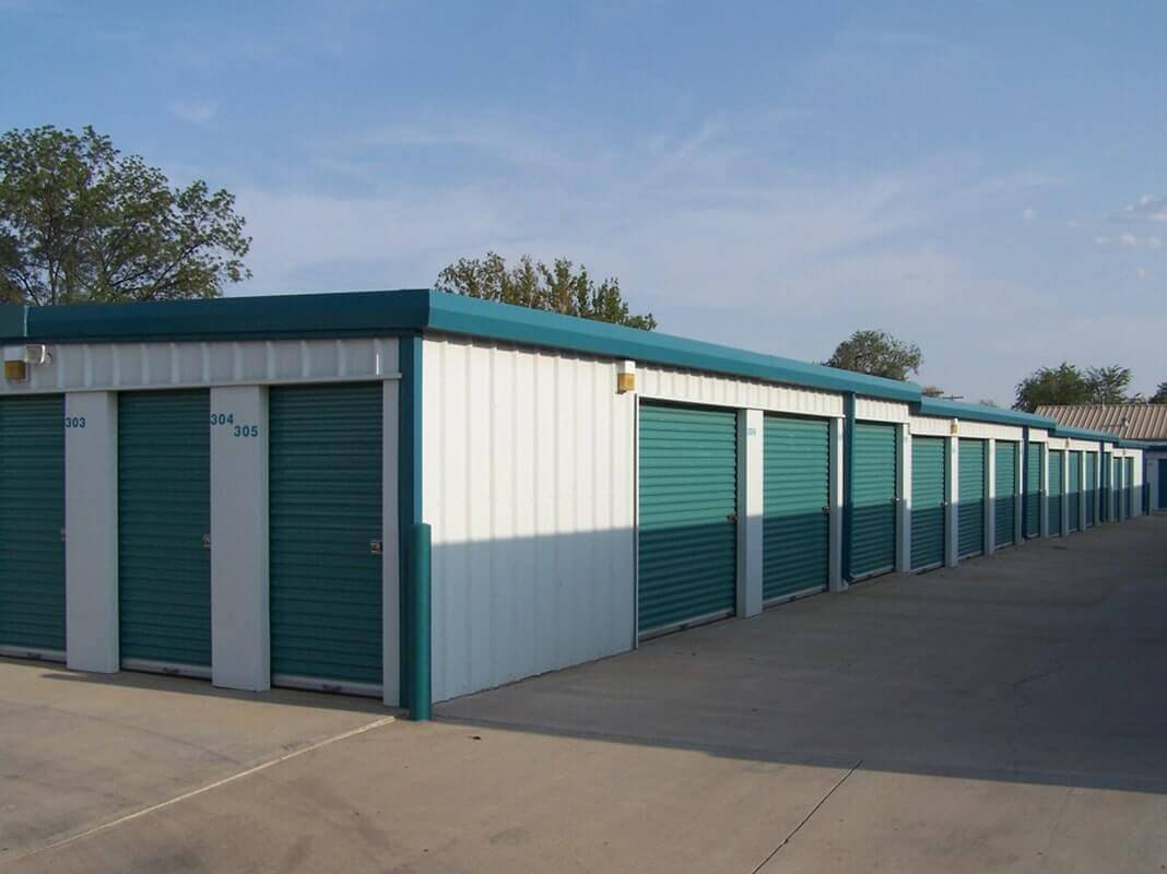 American Steel Buildings - Storage Unit Building with Green Trim and Green Doors